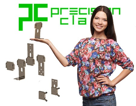 a young attractive woman holding up a scr heat sink she is smiling and looking at the camera